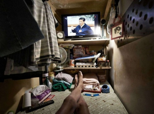 MANDATORY CREDIT: Benny Lam/SoCO. Only for use in story about Benny Lam/SoCO's work. Editorial Use Only. No stock, books, advertising or merchandising without photographer's permission Mandatory Credit: Photo by Benny Lam/SoCO /REX (8860783m) View of a tiny coffin home in Hong Kong Tiny 'coffin' homes, Hong Kong, China - 2017 For people living in the west, it's hard to imagine anyone living in an apartment this small. But for some of the poorest people in Hong Kong this is their home, all 40 square-foot of it. Hong Kong has long been known for its prosperity and its cosmopolitan success but beneath this glitzy appearance exists another reality: a world consisting of squatter huts, sub-divided units, cage homes, and coffin cubicle in dilapidated single-staircase buildings, on rooftops, and in cocklofts. Hong Kong's glitter conceals the 200,000 people who, no matter hard they try, can never afford anything more than this. The Society for Community Organisation (SoCO) has released a set of birds-eye images - taken by phtoographer Benny Lam - of low-income families, singletons, elderly and unemployed people living in urban slums to highlight the housing problem in Hong Kong. /Rex_Tiny_coffin_homes_Hong_Kong_China_20_8860783M/MANDATORY CREDIT: Benny Lam/SoCO. Only for use in story about Benny Lam/SoCO's work. Editorial Use Only. No stock, books, advertising or merchandising without photographer's permission /1706091247